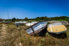 Old abandoned wrecked speed boat at ship or boat graveyard. Royalty Free Stock Image