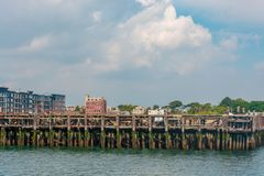Old abandonned pier in Boston. Massachussetts by a beautiful September Day stock photo