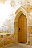 Old abbey door Stock Photo