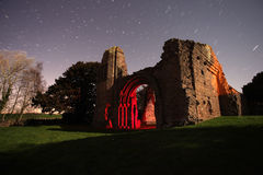 Old abbey ruins at night Stock Photo