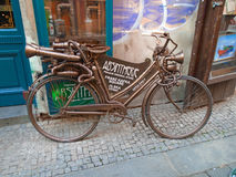 Old Absinthe abstract bicycle. Prague, Czech Republic, Stock Image
