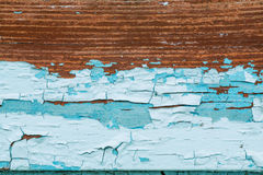 Old abstract colorful rusty background. Blue paint flaking and cracking on wood texture Stock Photography