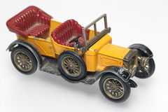 Old abused toy oldtimer. One of the many thousand  toys my brother is collecting. Metal oldtimer from the 1960's Royalty Free Stock Image