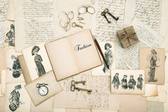 Old accessories, letters and fashion drawings from 1911. Antique accessories, old letters and fashion drawings from 1911. vintage nostalgic background Royalty Free Stock Images