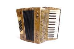 Old accordion. Studio shot of retro accordion over white background Royalty Free Stock Photo