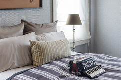Old accordion on bed in bedroom Royalty Free Stock Photos