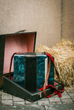 Old accordion in a suitcase Stock Photo