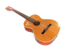Old acoustic guitar. Isolated on a white background Royalty Free Stock Photo
