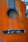 Old acoustic guitar. Closeup look at old acoustic guitar Royalty Free Stock Image