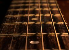 Old acoustic guitar. Close up strings of old acoustic guitar stock photography