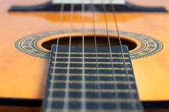Old acoustic guitar. Closeup wooden classical guitar. Old classical guitar with nylon strings. Old acoustic guitar royalty free stock photos
