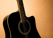 Old acoustic guitar Stock Images