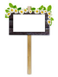 Old ad board with white paper and flowers Stock Image