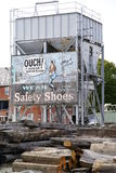 Old Ad on Construction Site. An old advertisement in a construction site Royalty Free Stock Photos
