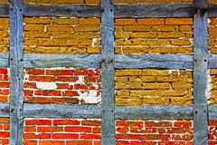 Old adobe and brick wall of half timbered house Stock Image