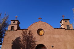 Old adobe church front Stock Photography
