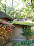 The old adobe house with a thatched roof Stock Photography