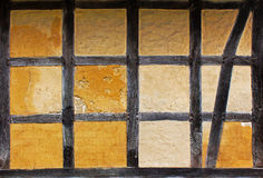 Old adobe wall of half timbered house Stock Photography