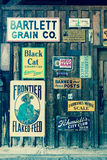 Old Advertising Signs posted in historic Centennial Ranch Barn, Ridgway, Colorado - a designated historic landmark Stock Image