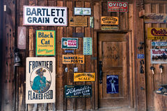 Old Advertising Signs posted in historic Centennial Ranch Barn, Ridgway, Colorado - a designated historic landmark Stock Photo