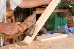 Old adze. In carpenters hands carving wood Royalty Free Stock Photography