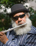 Old African American Musician Playing Flute. Outdoors Royalty Free Stock Image