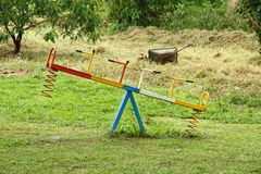 Old African See Saw. An old, but colorful, see saw in an African playground area royalty free stock photo