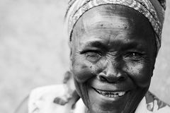 A Old African Woman Smiles With A Toothless Grin A Happy Old African Woman