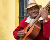 Old afrocuban street musician playing the guitar in Havana Stock Photo