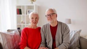 Senior couple recording video greeting stock video