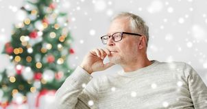 Senior man in glasses thinking Stock Photo