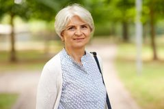 Portrait of happy senior woman at summer park royalty free stock images
