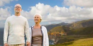 Happy senior couple over big sur coast Royalty Free Stock Photos