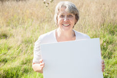 Old age woman holding blank sign Stock Images