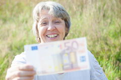 Old age woman holding fifty euro Royalty Free Stock Image
