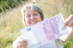 Old age woman holding five hundred Stock Image