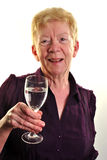 old age woman is holding a glass of water Stock Photo