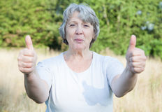 Old age woman showing thumbs up Royalty Free Stock Images