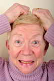 old age woman is very upset Stock Photo