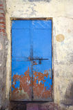 Old and aged blue metal door Royalty Free Stock Photos