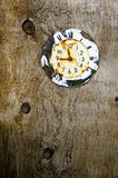 Old aged clock face on wooden background Stock Images