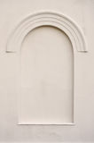 Old aged faux arch false fake window stucco frame. Old aged plastered faux arch false fake window stucco frame background copy space, light dark beige sepia Royalty Free Stock Photos