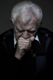 Old aged man mourns his wife Royalty Free Stock Photo