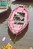 Old and aged red boat in Ganga river, Varanasi Royalty Free Stock Photos