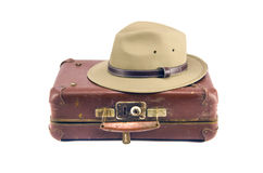Old aged suitcase for traveling and hat isolated on white Royalty Free Stock Image