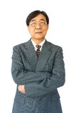 Old aged thai businessman with glasses is standing and looking Royalty Free Stock Images
