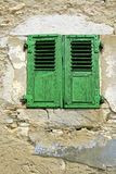 Old aged window in france. In a stone wall Royalty Free Stock Photo