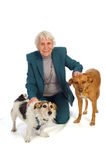 Old aged woman with pets Stock Photo