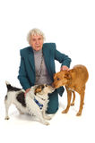 Old aged woman with pets Royalty Free Stock Photos