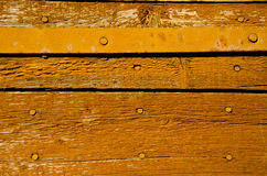 Old and aged wooden door fragment background Royalty Free Stock Photos